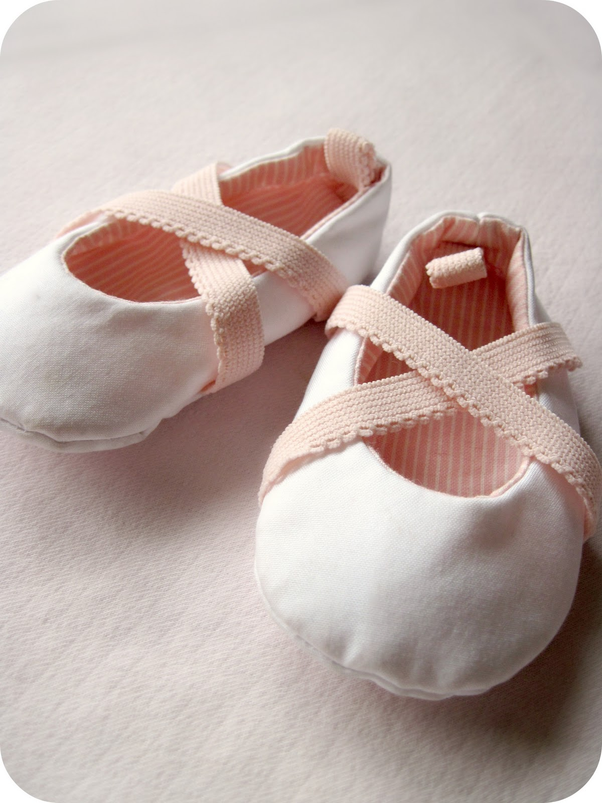 Sweet! This little shoe is a baby pink satin tied around the ankle with delicate silk ribbon. Soft and cozy for babys feet. Lined with wool blend felt. Perfect for any of babys special occasions. Each pair of shoes is handmade by me upon receiving your order. For a perfect fit, please see.